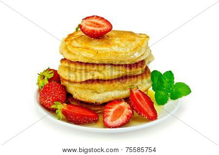 Flapjacks with strawberries and mint in plate