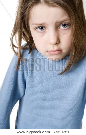 Cute Child Sulking Against White