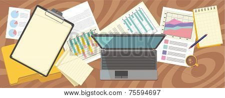 Top view laptop, papers with numbers and charts