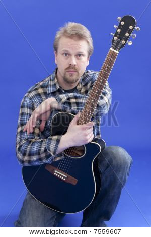 Portrait Of A Man With Guitar