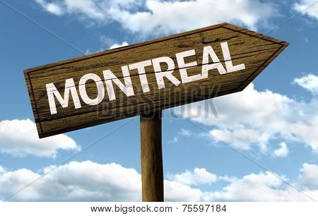 Montreal, Canada wooden sign on a beautiful day