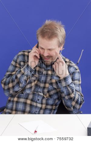 Man Takes A Personal Phone Call