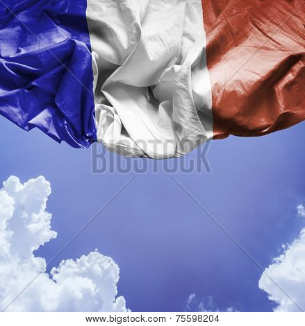 France waving flag on a beautiful day