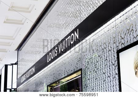 SINGAPORE - CIRCA MAY 2014: Louis Vuitton store. Forbes says that Louis Vouitton was the most powerful luxury brand in the world in 2008 with $19.4bn USD value.