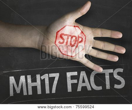Educational and Creative composition with the message Stop MH17 Facts on the blackboard