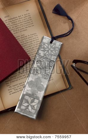 metal bookmark inside a book