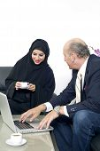 picture of hijabs  - Senior Businessman working with Arabian Businesswoman wearing hijab - JPG