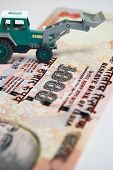 picture of earth-mover  - Earth mover concept of  making money with renting machine - JPG