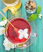 stock photo of jasmine  - tea with jasmin flowers in the cup - JPG