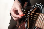 stock photo of guitar  - Female hand playing acoustic guitar - JPG