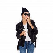 pic of teen smoking  - Hipster girl in sunglasses and black beanie smoking cigar - JPG