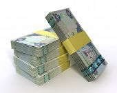 stock photo of dirhams  - A stack of bundled dirham banknotes on an isolated background - JPG