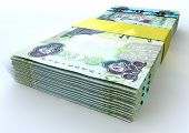 pic of dirhams  - A stack of bundled dirham banknotes on an isolated background - JPG