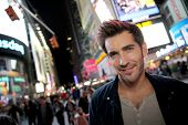 picture of broadway  - Man standing in Time Square on Broadway street - JPG