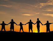 picture of holding hands  - Many people join hands to represent a family unity - JPG