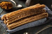 stock photo of churros  - Homemade Deep Fried Churros with Cinnamon and Sugar - JPG
