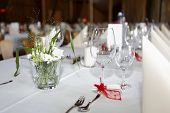 stock photo of wedding feast  - Laid wedding table with glasses and serviettes - JPG