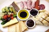 pic of vinegar  - Ploughmans Lunch antipasto style platter including crusty bread cheese cold meat ham olives olive oil and balsamic vinegar crackers pate and salad - JPG