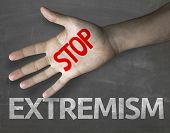pic of extremist  - Educational and Creative composition with the message Stop Extremism on the blackboard - JPG