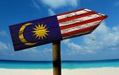 foto of bandeiras  - Malaysia wooden sign with a beach on background  - JPG