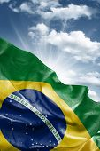 stock photo of flutter  - Amazing Flag of Brazil with a beautiful blue sky as the background  - JPG