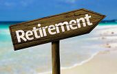 image of retirement age  - Retirement wooden sign with a beach on background - JPG