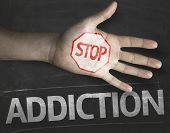 picture of addict  - Educational and Creative composition with the message Stop Addiction on the blackboard - JPG