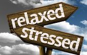 stock photo of reduce  - Relaxed x Stressed creative sign with clouds as the background - JPG