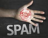 image of no spamming  - Educational and Creative composition with the message Stop Spam on the blackboard - JPG