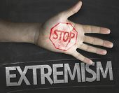 stock photo of extremist  - Educational and Creative composition with the message Stop Extremism on the blackboard - JPG