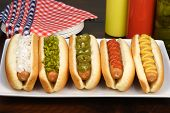stock photo of hot dogs  - hot dogs on a nice table setting rich textures colors and flavors - JPG