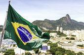 foto of olympic mountains  - Brazilian waving flag on Rio de Janeiro - JPG