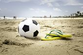 image of ipanema  - Soccer ball and a yellow Flip flop on the beach - JPG