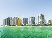 picture of jade blue  - Beautiful Jade Beach in sunny isles beach with blue sky and skyscraper - JPG