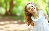pic of charming  - Cute baby girl shone with happiness curly hair charming smile sunny summer portrait - JPG