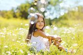 stock photo of have sweet dreams  - Child having fun in summer day with soap bubbles - JPG