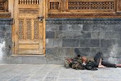 stock photo of peddlers  - Homeless man in India sleeping on the street - JPG
