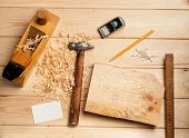 stock photo of work bench  - joinery tools on wood table background with business card and copy space - JPG