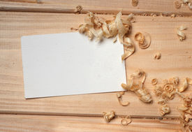 stock photo of woodcarving  - business card on wooden table for tools - JPG