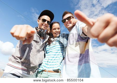 summer holidays and teenage concept - group of teenagers outside