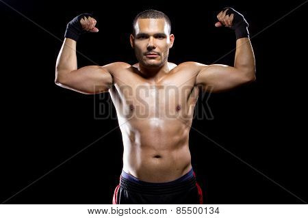 Latin Fighter Flexing Muscles