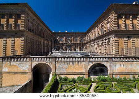 Facade Of Pitti Palace With Fountain And Boboli Gardens