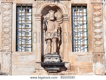 Sculpture On The Entrance To Coimbra University