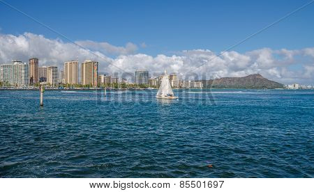 Sailboat arriving in Waikiki.
