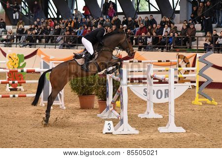 KAPOSVAR, HUNGARY - MARCH 15: Zsolt Kiss jumps with his horse (Carnero) on the Masters Tournament International Jumping Competition, March 15, 2015 in Kaposvar, Hungary