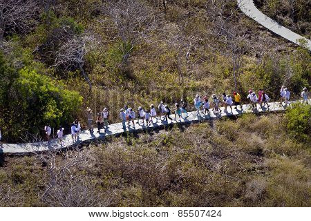 Tourists walking along Frigate bird hill, Galapagos