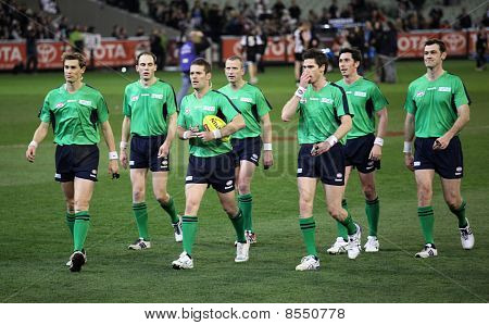Melbourne - August 21:  Umpires Leave The Field After Collingwood's Win Over Adelaide - August 21, 2