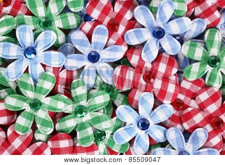 Flower shaped applique pile made of plaid textile