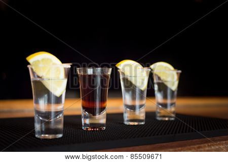 Brandy And  Three Tequila Shots With Lemon