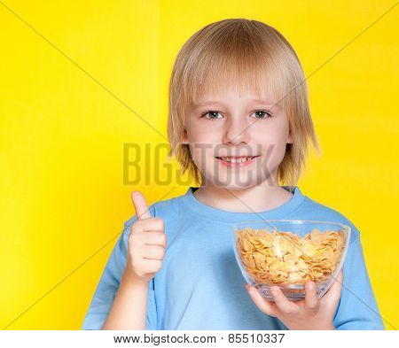 Blond boy kid child eating corn flakes cereal